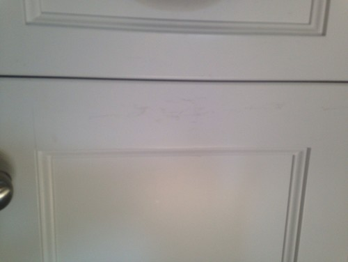 Tarnish scuffs on painted white cabinets