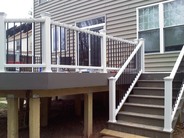 Grey Trex Deck With Pvc Railings And Black Spindles