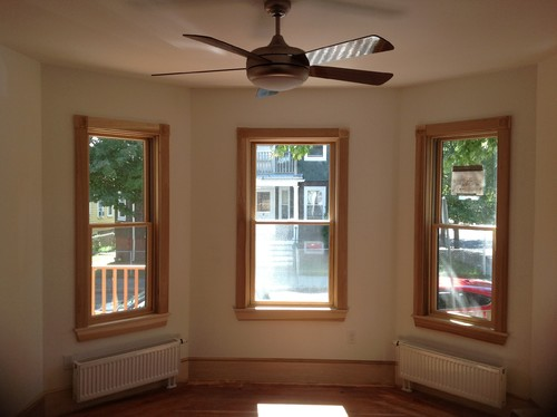 Cant decide whether to stain or paint wood trim for What to paint trim with