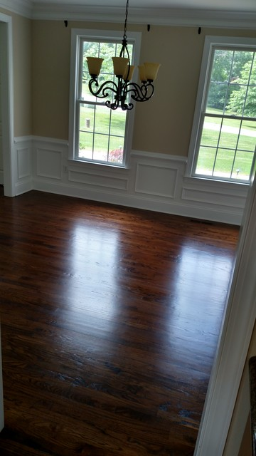 Red oak hardwood flooring with medium brown stain for Hardwood floor dealers