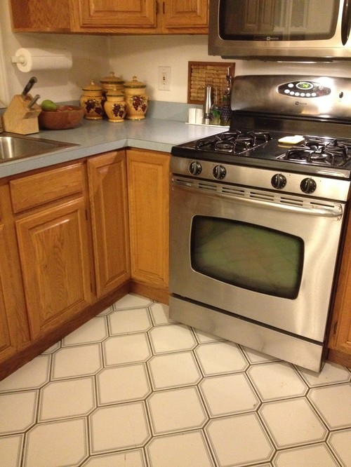 Black granite uba tuba countertops to replace the ugly old blue ones