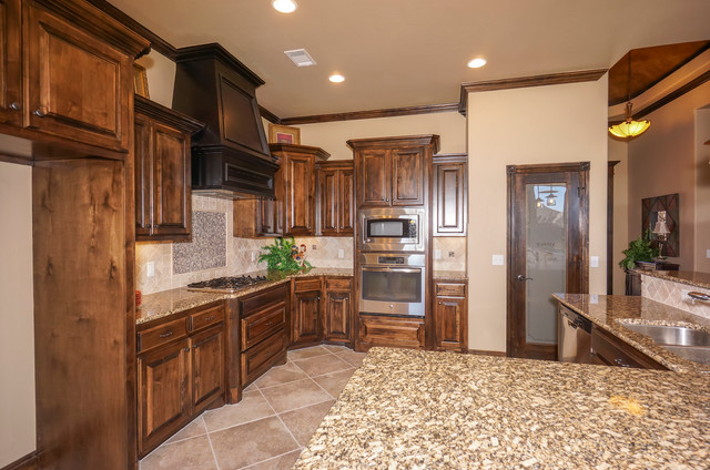 Traditional Kitchen with Dark Cabinets and Granite Countertops