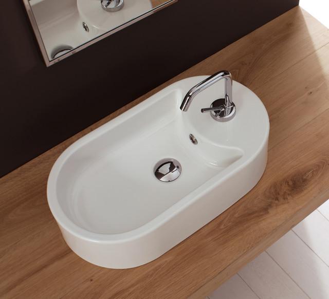Oval shaped above counter vessel ceramic sink for Designer bathroom sinks basins