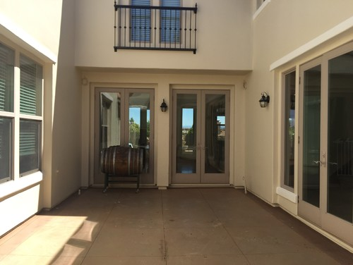 Decorating enclosed courtyard for Enclosed courtyard house plans
