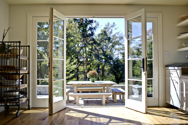 Kitchen french doors open traditional patio for Double opening patio doors
