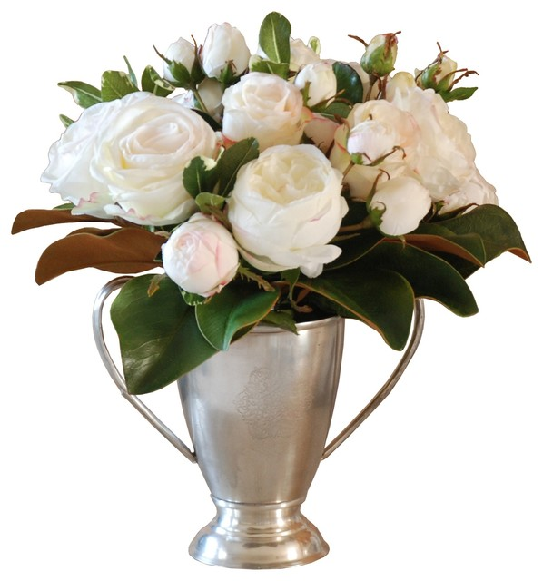 Champagne Roses And Magnolia Foliage In Silver Vase