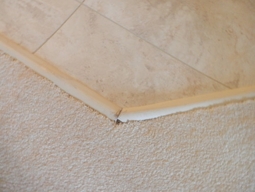 how to raise carpet to meet tile