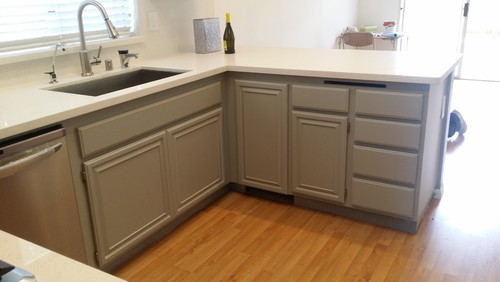 Turning an old wooden kitchen into a modern painted finish.