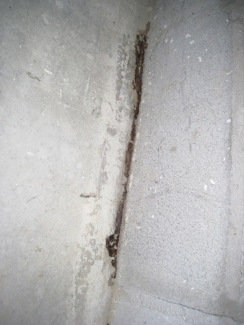 Concrete garage floor edge crumbling for Crumbling concrete floor