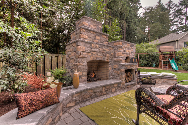 Outdoor fireplace with pizza oven klassisk portland for Paradise restored landscaping exterior design