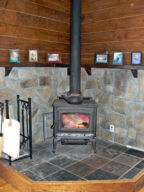 Wood Stove Stone Surrounding And Mantle Farmhouse