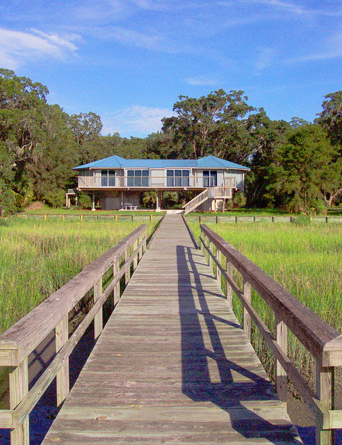 Elevated hurricane proof home on pilings stilts other for Hurricane proof home designs