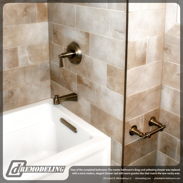 White tub with oil rubbed bronze fixtures traditional bathroom philadelphia by dremodeling for Traditional bathroom fixtures