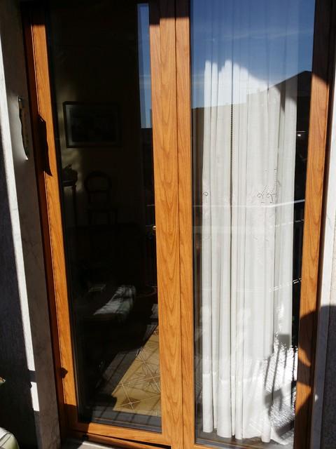 Sostituzione infissi in alluminio a taglio termico color for Infissi color legno