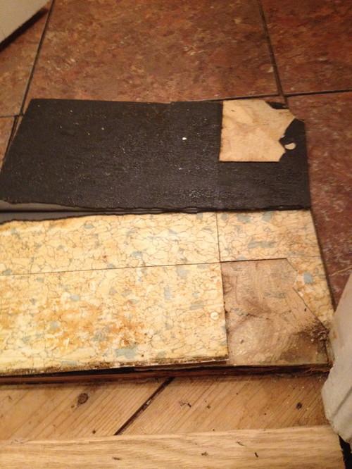 Removing old vinyl floor tiles
