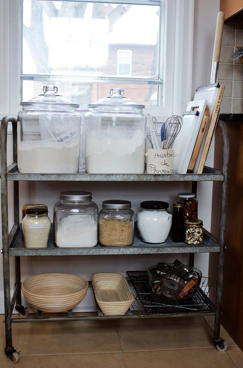 Use a bar cart as a rolling baking station in your KITCHEN! See all 15 CREATIVE ways to use and style a bar cart in your home.