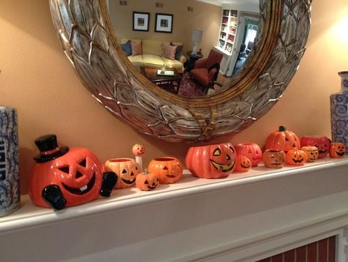 Halloween jack-o-lanterns on mantel.