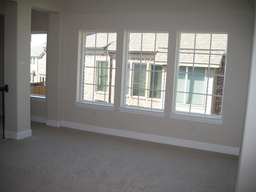 Synthetic plantation shutters for Should plantation shutters match trim