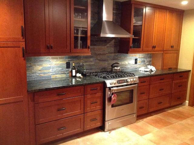 Kitchen remodel. Cherry cabinets, slate backsplash, ubatuba granite