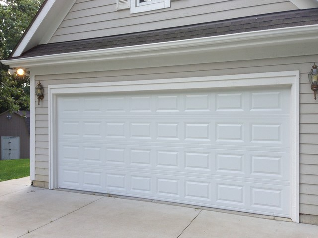 Traditional raised panel garage doors traditional garage detroit by premier door service for Premier garage doors