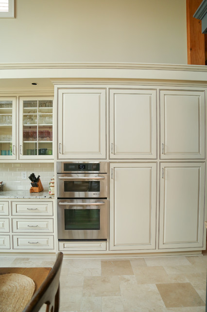 cabinets painted cream with a chocolate glaze heritage