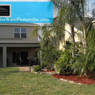 Home design - large tropical home design idea in Orlando