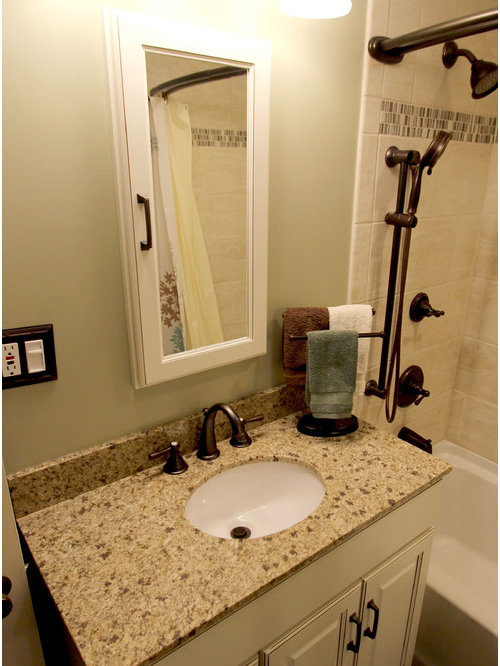 burnt sienna white vanity with granite coutnertop and tiled shower