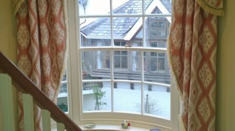 beautiful bow- windowed stairwell  a classic valance and tail treatment.