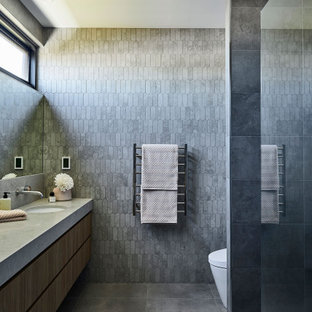 Large contemporary master bathroom in Geelong with flat-panel cabinets, dark wood cabinets, gray tile, mosaic tile, grey walls, cement tiles, an undermount sink, engineered quartz benchtops, grey floor, an open shower, grey benchtops, a single vanity and a floating vanity.