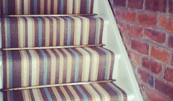 kersaint cobb morroco runner with vintage stair rods, with open brick wall