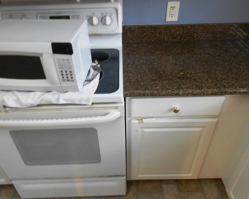SaveEmail. 8-17-12 Desert Brown Granite great contrast with White Cabinets
