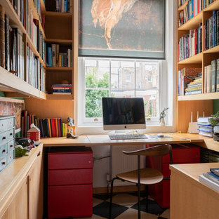 Design ideas for a medium sized traditional home office in London.