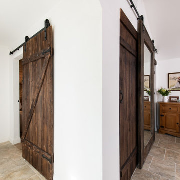 Room Addition with Barn Doors for Bathroom Entrance and Closet