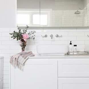 Photo of a transitional bathroom in Canberra - Queanbeyan with shaker cabinets, white cabinets, a freestanding tub, an open shower, a one-piece toilet, white tile, subway tile, grey walls, porcelain floors, a vessel sink, engineered quartz benchtops, an open shower, white benchtops, a double vanity and a floating vanity.