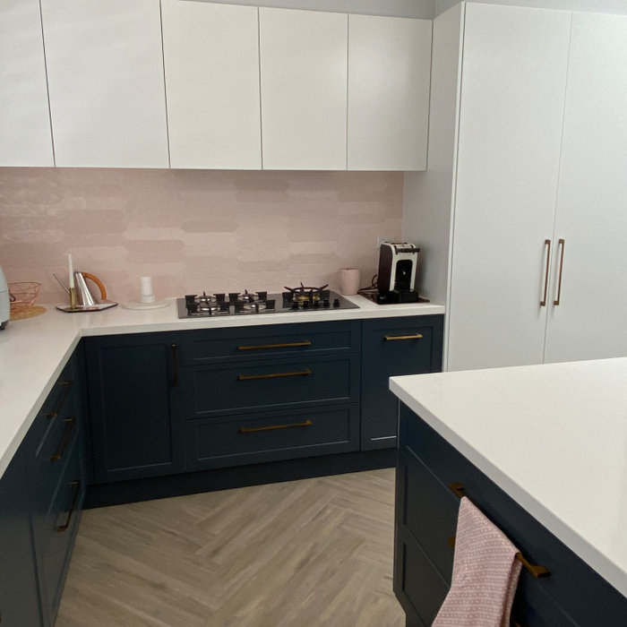 Shaker doors and drawer fronts, lower cabinets a dark blue and the remaining white polyurethane - matt finish