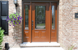 Brick Entry with Wooden Front Door & Hanging Plant