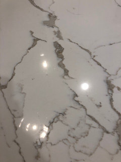quartz countertops that look like marble carrara marble it looks great with the laza and think does have browngold her is close up picture its hard to capture in pictures but we love it help need quartz that looks like calacatta marble