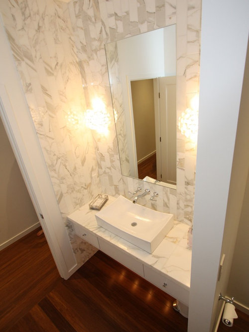 Powder Room Design Ideas, Remodels & Photos with Bamboo Floors and Stone Tile