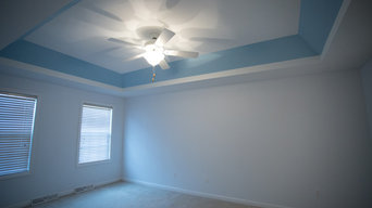 Bedroom with Accented Ceiling