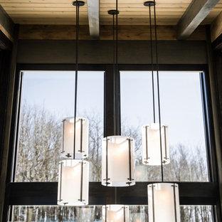 На фото: узкая прихожая в современном стиле с деревянным потолком и деревянными стенами с