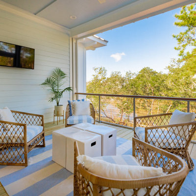 Deck - huge coastal second story cable railing deck idea in Charleston with a roof extension