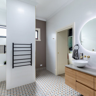 Design ideas for a contemporary bathroom in Adelaide with flat-panel cabinets, medium wood cabinets, a curbless shower, white tile, a vessel sink, multi-coloured floor, grey benchtops, a niche, a shower seat, a single vanity and a floating vanity.