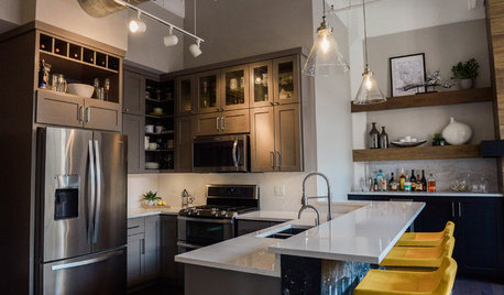 Gray Cabinets and a Wood-Wrapped Fireplace Update a Downtown Loft