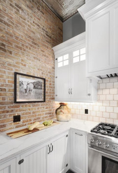 Subway Tile Backsplash Next To Brick Wall
