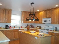 My kitchen has white appliances and light oak cabinets. How can I make it look updated?