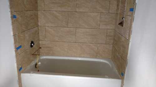 "I am having a small bathroom remodeled. The tile is about done BUT, there is a 1/2"" gap between the wall and the bullnose. The contractor says that the tile ..."
