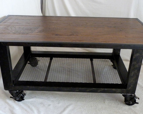 Rolling Industrial Coffee Table From Salvaged Steel Flooring Remnants
