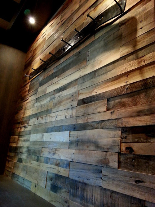 Recycled pallet and reclaimed wood paneling for Reclaimed pallet wood wall