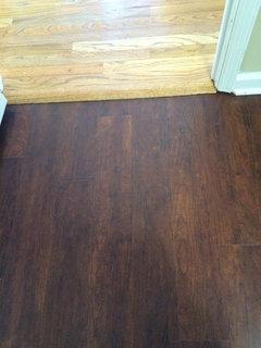 Luxury Vinyl Planks In Foyer Adjacent To Real Hardwoods