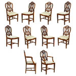 Niagara Furniture - Sweet Heart Dining Chairs, Set of 10 - A set of 10 Solid Mahogany Sweet Heart Dining Chairs by Niagara Furniture, the set consisting of 2 arm chair s and 8 side chairs. This style of chair are also known as a Heart Shaped Chairs. They have an elegant and stylish back featuring Drape Carvings as well as interconnected loops crested by a hand carved Fleur de Lis design. This type of back is very difficult to produce. Our version is made from hand carved solid mahogany. Tapered reeded solid mahogany legs on the front of the chair are connected with cross stretchers to the rear legs for extra support.